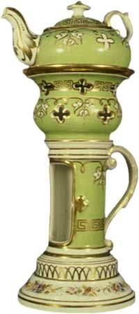 Teapot #263  Most unusual shape, apple green with gold and white trim, garlands of flowers around bottom of base; base is long cylinder-like with large white and gold handle and long open panel for candle to be shown; stand is urn-shaped with Greek key band in gold ne  Acquired in Berne