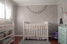 The stenciled accent wall takes this shabby chic nursery to the next level! #nursery #shabbychic