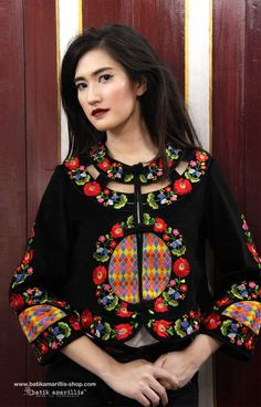 Beautiful and extraordinaire Batik Amarillis's Anais Jacket which features Hungarian style embroidery and inspired by the beautiful windows and doors from all over the world's design:it also also the symbol of new hopes and dreams. It has unique cutting and the design which features hand made chinese frog buttons and chic slimming silhoutte.