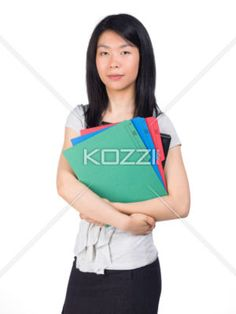 Business Woman Holding Folders - A well-dressed woman holds some folders.