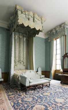 """The Blue Bedroom at Belton House, Lincolnshire, UK. The bed is early C18th, in the style of Francis Lapiere, a Huguenot craftsman. The bed was reupholstered in 1813 in blue silk damask and may have been converted to the """"angel tester"""" form at the same time. The day-bed at its foor is late C17th"""