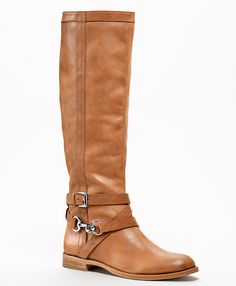 Own these Coach boots- Love them!  Comfy and cute- But have no traction in the snow and ice.