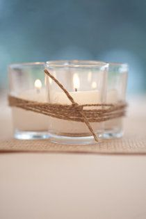 Simple DIY centerpiece - votives in small glass jars tied with twine for a rustic nautical touch