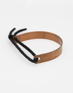 """Chunky bracelet from Maslo Jewelry, with curved copper bar on a knotted rope.  Handmade in USA  Approximately 3"""" diameter"""