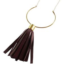 This handmade necklace features a hammered brass crescent adorned with a handmade deep wine colored leather tassel. Everything is strung on about 28 inches of gold fill chain with a gold fill clasp.  Brass crescent is about 3 inches at its largest point Tassel is about 4 inches long.  This piece is part of my summer Urban Bohemian Collection. It is a return to my first collection's aesthetic of black leather and brass combinations. Urban Bohemian takes that vision one step further with new…