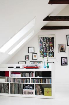 Small Space Living: 12 Creative Ways to Use an Attic Space. Media or entertainment room in the attic. I need those windows too. Cd Storage, Vinyl Storage, Record Storage, Media Storage, Storage Ideas, Attic Rooms, Attic Spaces, Small Space Living, Small Spaces