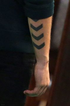 What does chevron tattoo mean? We have chevron tattoo ideas, designs, symbolism and we explain the meaning behind the tattoo. Chevron Tattoo, Meaning Of Arrow Tattoo, Tattoos With Meaning, Subtle Tattoos, Trendy Tattoos, Men Tattoos, Guy Chest Tattoos, Body Art Tattoos, Sleeve Tattoos
