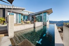 Built by the founder of a car company, this glass-and-concrete house in Malibu, Calif., includes accents that allude to a race's checkered flag Pacific Coast Highway, Big Sur, Newport Beach, Santa Monica, Clouds, House Design, Contemporary, Mansions, Architecture