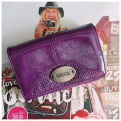 """Purple Kenneth Cole Wallet Like New Made by: Kenneth Cole  A Macy's Purchase Purple color Textured Patent Leather style with lots of space in side. Logo is sported on the brushed metal front emblem and also back Change/Key holder. Snap closure. Measurements Closed: 4""""Tall X5.5""""Wide. Removed tags and used once last year. It has been stored. Excellent condition. I also have a large black NWT. Listed. Thank you for browsing my closet. Kenneth Cole Reaction Bags Wallets"""
