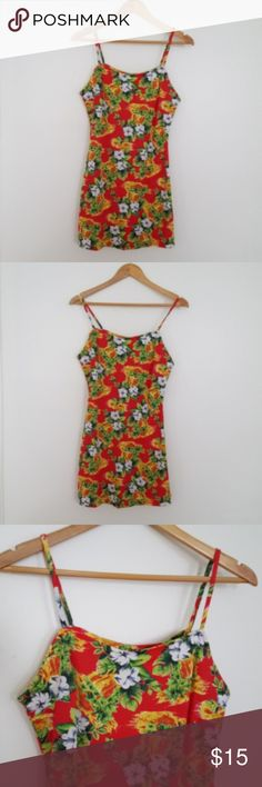 """Hawaiian Floral Mini Slip Dress Vintage slip Hawaiian red, yellow, and green mini dress with spaghetti straps. Pattern is most floral with either a waterfall or lava motif. Polyester and spandex blend fabric has a flattering stretch and has a slight flair after it hits the waist. Marked size large, but closer to a modern small/medium. 33"""" long, 15.5"""" across the waist, and 17.5"""" across the bust. See last pic for small imperfection on the back of the dress. Mine Dresses Mini"""