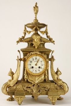 ♔ 19th century French Renaissance Revival dore' bronze clock, the clock face surmounted by a maiden's mask and lidded urn