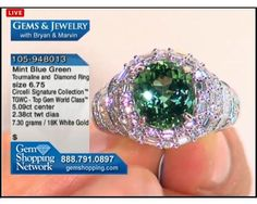 Mint green tourmaline of 5 carats set in a diamond mount with over 2 carats of diamonds in 18k white gold.