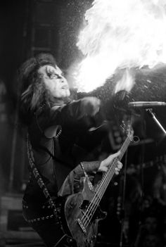 Gene Simmons Breathing Fire [1974] Great fire-spitting photo that I cannot date for the life of me.  Gene's costume and guitar is simi...