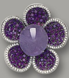 LAVENDER JADEITE AND DIAMOND RING Modelled as a flower, centring on a translucent lavender jadeite cabochon, to petals set with brilliant-cut treated purple diamonds together weighing approximately 1.60 carats, highlighted by brilliant-cut diamonds, mounted in 18 karat white gold. Ring size: 5¼ Lavender jadeite approximately 12.03 x 10.80 x 6.22mm.