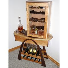 There is no reason I would ever need this, but is awesome nonetheless. Custom Made Humidor / Wine Rack by Custom Furniture Creations