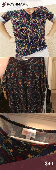 XS Lularoe Irma blue background not black Super cute! I found a lady on pintrist wearing this print it just has a black background but the one I'm selling is a blue background. Still super cute =] XS smoke free Pet free. Only worn once :) LuLaRoe Tops