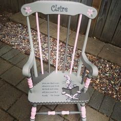 Hand painted Dr Seuss kids rocking chair.  Girls room was done in dark/light grey with pink so I painted chair to match!  Dr. Seuss quote perfect for little readers.