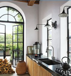 Love this kitchen (though the pile of wood and oversized urn blocking the door is way too precious)