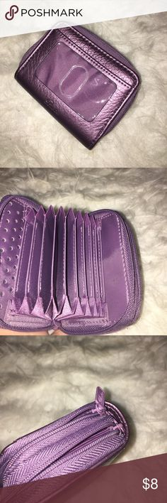 Purple Coin/ Credit Card Carrier Pouch Never used before, in great condition. Has a place to store an ID, coins, cash, and credit cards. There are 11 slots inside that could store about 4 credit cards each. Zippers on the outside! Accessories Key & Card Holders