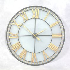 BLACK AND GOLD AND GLASS ROMAN CLOCK