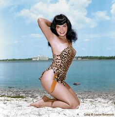 Bettie Page posing in Miami wearing her own designed and hand sewn leopard bathing suit, b&w photo taken by Bunny Yeager, colorized by Louise Baranoski.