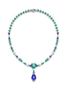 Piaget Necklace in 18K white gold set with 1 pear-shaped center blue sapphire, 1 cushion-cut center emerald, 10 pear-shaped blue sapphires (approx. 4.59 cts), 11 pear-shaped emeralds, 48 round emeralds, 82 brilliant-cut diamonds, 6 pear-shaped diamonds and 4 round blue sapphires.