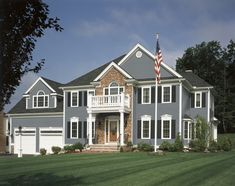 Light Grey House With Dark Grey Shutters And Dark Grey