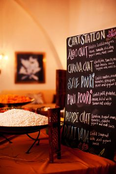 Chaat Station Chalkboard sign- Love this idea for a pre-wedding event like a sangeet night or a mehndi night. The menu is fun and colorful and adds a bit of DIY uniqueness to your Indian wedding decor. Indian Wedding Food, Wedding Food Menu, Wedding Food Stations, Desi Wedding, Wedding Catering, Indian Weddings, Wedding Snacks, Wedding Foods, Reception Food