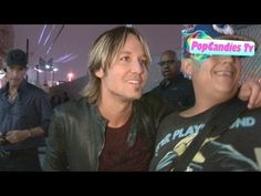 Keith Urban shows his Love to fans after Live Performance in Hollywood.. so sweet. He makes sure he gets every single person :)