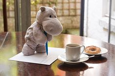 Tiny Hippo Mails Letter in London