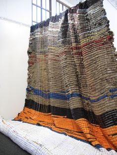 anthro macrame displays by Jessica Pezalla (and anthro display team) via Bramble Workshop (jesicca's design studio)   jersey fabric strips on metal supports