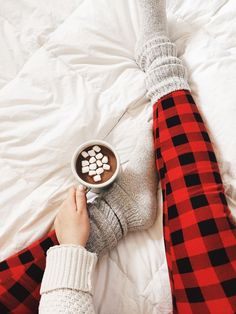 Snuggled up with a cup of hot chocolate.