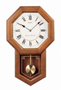 Seiko Wall Pendulum Schoolhouse Clock Dark Brown Solid Oak Case: Schoolhouse style clock design Dark brown solid oak case Westminster/Whittington quarter hour and hourly chime Curved glass crystal Pendulum style Dimension:- 23 x 14 x 5 inches Tabletop Clocks, Wood Clocks, Westminster, Clock Antique, Chiming Wall Clocks, Pendulum Wall Clock, Crystal Pendulum, Glass Crystal, White Clocks