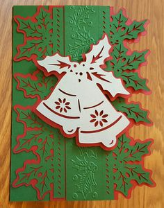 I made this Christmas card from Anna Griffin Christmas Cards Cricut cartridge, in green, red, and silver metallic cardstock, and I used AG Scattered Holly embossing border #AnnaGriffin #CrucutExploreAir #Cricut #Cuttlebug #ChristmasCard #Handmade