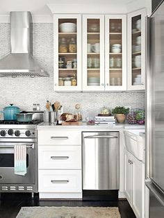 Stretch a small kitchen space without a major remodel. Check out these small kitchen ideas for cabinetry, color schemes, countertops, and more that make a little kitchen look and feel spacious. Little Kitchen, New Kitchen, Kitchen Dining, Kitchen Decor, Kitchen Small, Kitchen White, Kitchen Ideas, Basic Kitchen, Small Kitchens