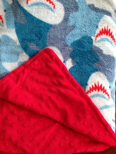 Super soft shark blanket in blue and red  on Etsy, $40.00