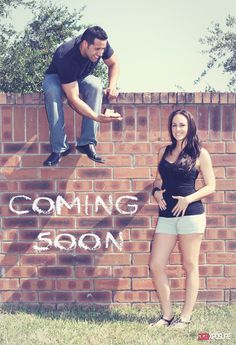 Pregnancy announcement with mother-to-be's first baby shoes when born.