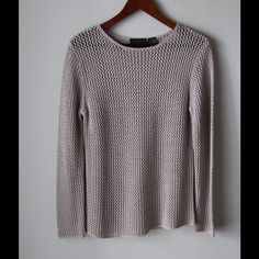 """Tan loose knit sweater Tan colored loose knit sweater - acrylic - long sleeves - rounded neckline - no holes or tears - chest across measures 17"""" - total length measures 25"""" - size S Relativity Sweaters"""