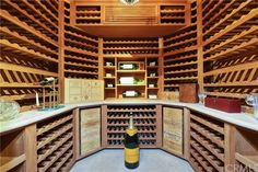 The 1,000+ bottle wine cellar in this Laguna Beach property listed by Tim Smith is perfect for an oenophiles extensive collection and is almost a work of art.