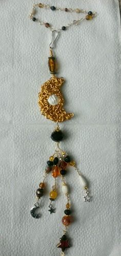 Wire wrapped carved bone moon car charm. Beaded sun catcher.