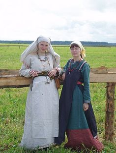 11th century Girls by Antalika.deviantart.com on @deviantART. Note the way the woman on the right has belted the rear panel, only, of her two-hanging-panel apron dress.