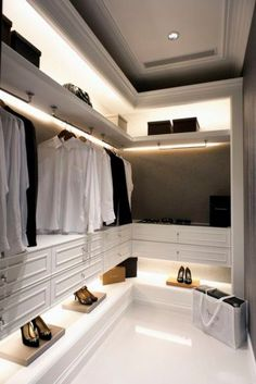 Shelves lit with recessed lights. Note the bevel to allow light to ...