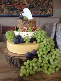 A minimally decorated three tiered cake, made up of a Belton Farm Mature Cheddar, Wensleydale & Cranberry and Sticky Toffee Cheddar with a Neufchâtel Brie Heart to decorate.