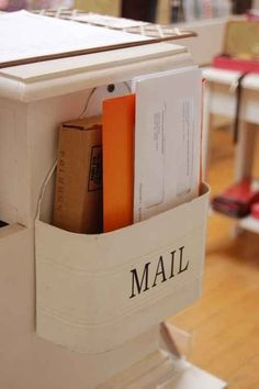 Hang your mail holder on the side of a table or kitchen counter. | 34 Ingenious Ways To De-Clutter Your Entire Life