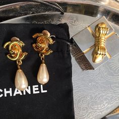 Chanel Authentic Vintage Pearl Drop Clip Earrings Chanel Authentic Pearl Drop Vintage earrings!  Gorgeous Drop Pearl earrings with Gold Signature Logo .  Comes with dust bag!  Circa 1980 CHANEL Jewelry Earrings