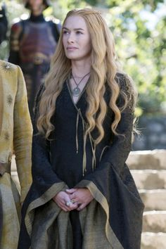 Cersei's soft curls topped with tiny braids. See the 7 other best hairstyles on Game of Thrones worth trying IRL.