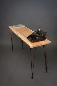 A great, simple desk,made of reclaimed wood with avintage typewriter!