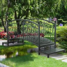 Create an enchanting and sophisticated outdoor living space with the Sunjoy Garden Bridge. Crafted out of weather resistant steel, this elegant garden bridge features a slatted walkway and slatted ste