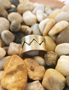 The Cheveron Paired Ring is a Brushed Gold Metal