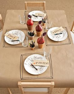 my next dinner gathering will definitely have a craft paper table covering and drawing materials.
